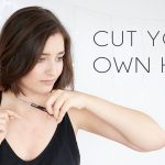The image shows a lady cutting her own hair