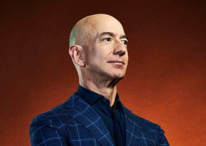 How much Jeff Bezos make in a day